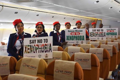 The crew of Air Peace, the Nigerian airline with posters against xenophobia. / Twitter @flyairpeace