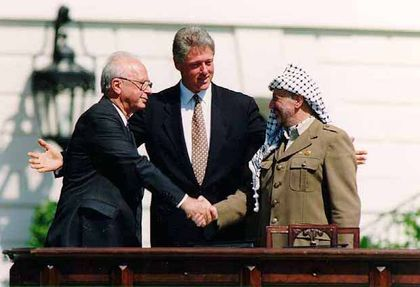 Yitzhak Rabin and Yaser Arafat, with Bill Clinton as witness signed thr Oslo agreement  in 1993. /  Wikimedia Commons.