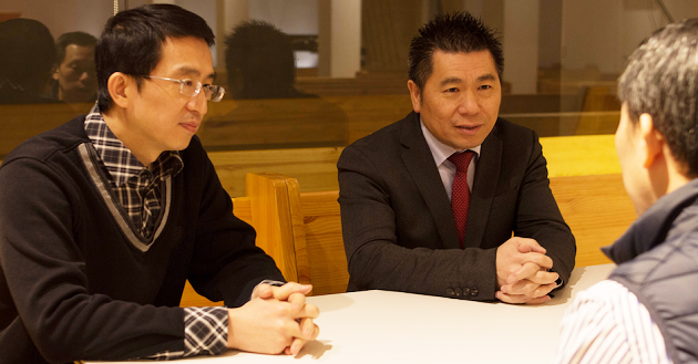 Pastor Rongen Li with Zhengbo Chen, president of the Chinese Christian Church in Spain, in one of the church premises in Barcelona. / Jonatán Soriano,