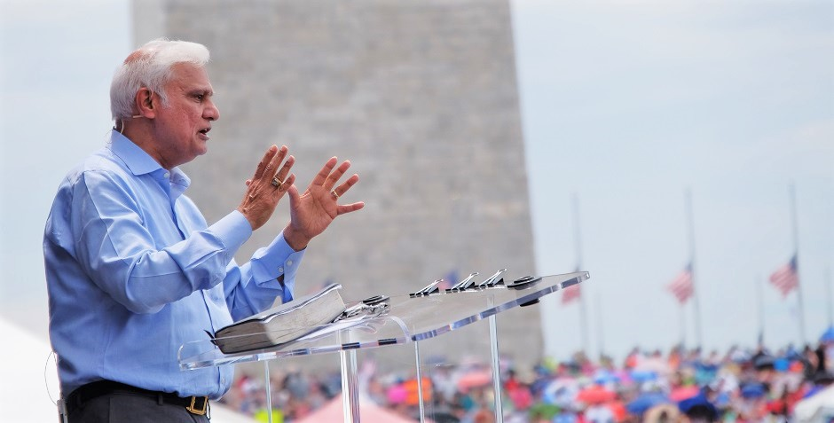 "Ravi Zacharias addresses a crowd gathered on the National Mall, Washngton D.C. for Together 2016. / <a target=""_blank"" href=""https://www.rzim.org/"">RZIM</a>,"
