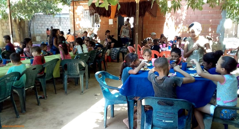 """In one year, the children's soup kitchens in Maracaibo managed by local evangelical churches and supported by the Solidarity Alliance have served 202 boys and girls five days a week. / <a target=""""_blank"""" href=""""https://www.alianzasolidaria.org"""">Alianza Solidaria</a>,"""