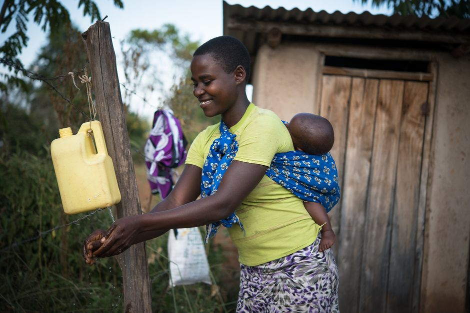 """A mother and her son who have been part of a USAID program. / Photo: <a target=""""_blank"""" href=""""https://www.usaid.gov/"""">USAID</a>.,"""