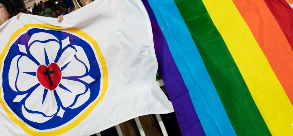 "Lutheran and LGBT flags. / Photo: <a target=""_blank"" href=""https://www.elca.org/lgbtq"">ELCA</a>,"