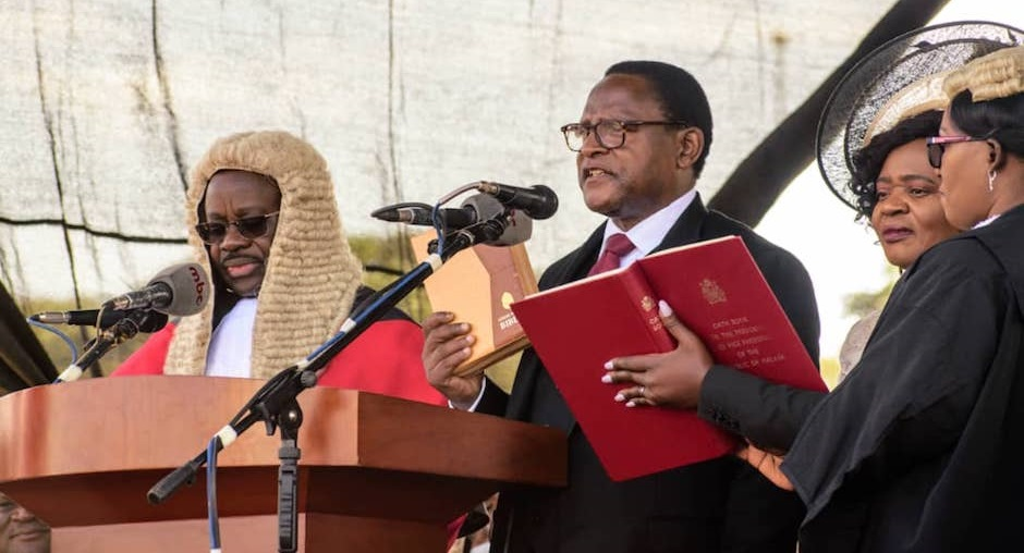 """President Lazarus Chakwera taking office with a Bible in hand./ <a target=""""_blank"""" href=""""https://twitter.com/lazaruschakwera"""">@LAZARUSCHAKWERA</a>,"""