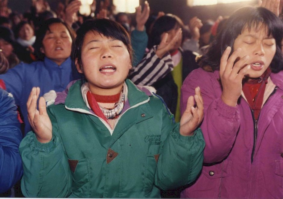 """Chinese Christians during a service. / <a target=""""_blank"""" href=""""https://www.opendoorsusa.org/"""">Open Doors USA</a>,"""