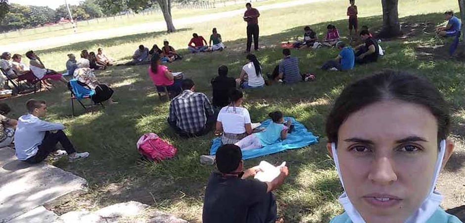 Members of Jehovah Shalom Church gathered in a park after their church was closed. / Jehová Shalom church Facebook.,