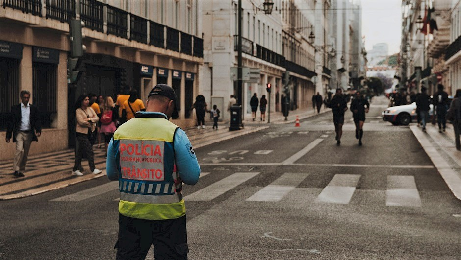 "A police officer in Lisbon, Portugal. / Photo: <a target=""_blank"" href=""https://unsplash.com/@yuricatalano"">Yuri Catalano</a>, Unsplash, CC0,"