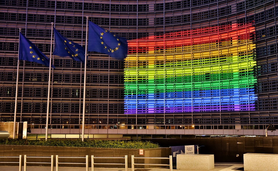 "The head quarters of the European Commission in Brussels, lit with the rainbow flag colours. / Photo: L. Kobus, <a target=""_blank"" href=""https://audiovisual.ec.europa.eu/en/photo/P-043853~2F00-01"">European Commisison</a>,"
