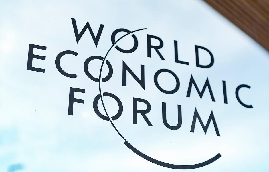 "The logo of the WEF on a window in Davos. / <a target=""_blank"" href=""https://unsplash.com/@evangelineshaw"">Evangeline Shaw</a>, Unsplash, CC0,"
