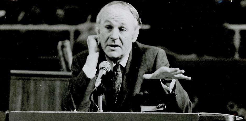 "John Stott, in 1973. / Photo: <a target=""_blank"" href=""https://www.flickr.com/photos/ifesworld/6941286181"">IFES World Flickr</a>, CC.,"