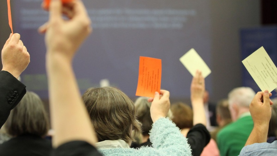 """A vote at a gathering of the Church in Wales. / Photo: <a target=""""_blank"""" href=""""https://www.churchinwales.org.uk/en/"""">Church in Wales </a>.,"""